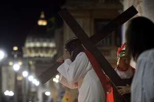 A man reenacts the way of the cross by Jesus Christ on Via della Conciliazione leading from St. Peter's Basilica at the Vatican in Rome last month. The way Jesus looked isn't important. His teachings and the meaning of his life and death are what matter.