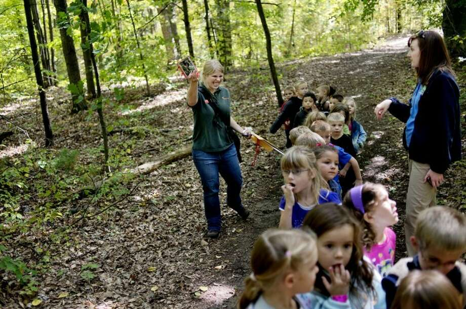 NICK KING | nking@mdn.netChippewa Nature Center educator Michelle Fournier, left, leads Erin Southwell's kindergarten class on a nature walk outside Floyd Elementary School. Fournier gave a lesson to the students about classifying insects and other animals. Photo: Nick King/Midland  Daily News
