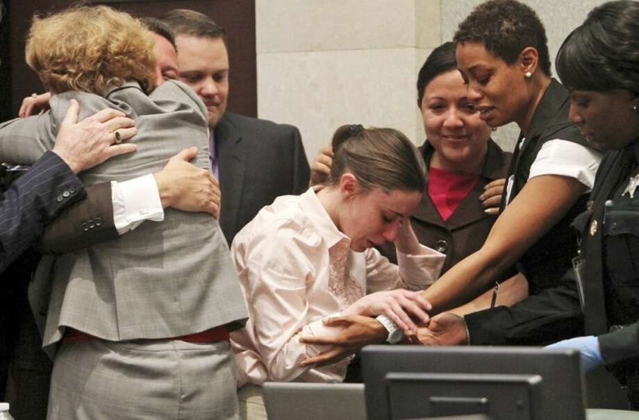 AP photoCasey Anthony is overcome with as her lawyers, Jose Baez and Dorothy Clay Sims, hug after Anthony was acquitted of murder charges in Orlando, Fla., Tuesday. Photo: Red Huber
