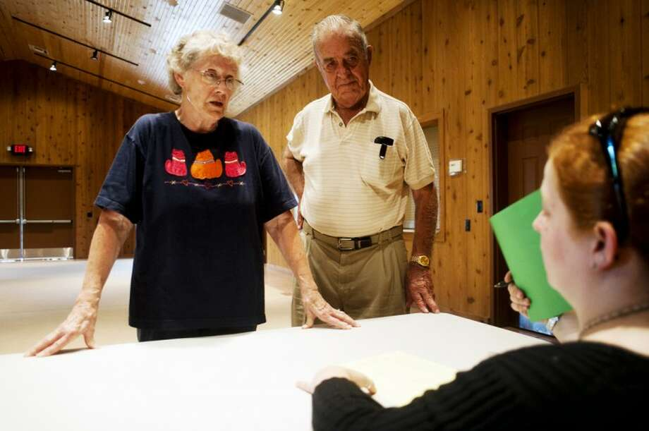 NEIL BLAKE | nblake@mdn.netBarb Hickman, 79, and Ed Whisler, 82, talk with Katie Schappel about their wedding arrangements at Heritage Park in Midland. The couple was engaged 61 years ago, but Hickman called off the wedding. They have since been reunited and will be married Saturday. Photo: Nick King/Midland  Daily News