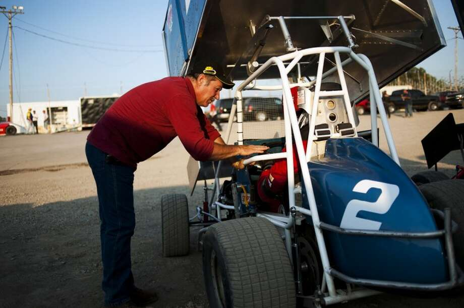 Kim Valentine of Blanchard, left, talks to driver Terry Walch before the mini-sprint race on Friday at Tri-City Motor Speedway. Friday was the grand opening of the racetrack. Photo: NEIL BLAKE | Nblake@mdn.net