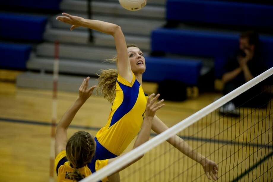 NEIL BLAKE | nblake@mdn.netMidland's Tori Blake spikes the ball during the match against Bay City Western at Midland High School on Tuesday. Photo: Neil Blake/Midland  Daily News