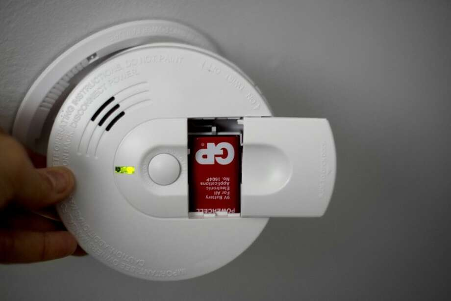 Changing the batteries in smoke detectors and carbon monoxide detectors is an easy task that can potentially save lives. Photo: Nick King/Midland  Daily News