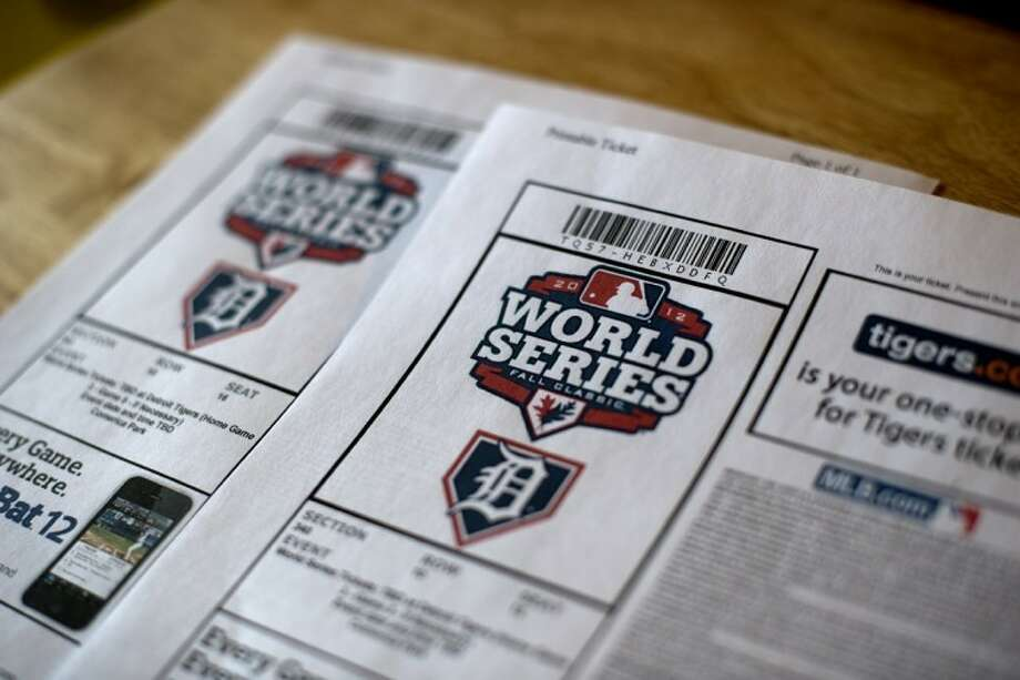 Kurt Borgman of Midland is having a drawing for one of his two World Series tickets at his church, Resurrection Life, on Sunday. Photo: Neil Blake/Midland  Daily News