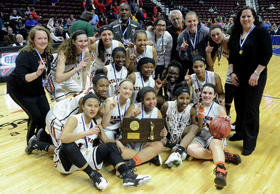 Stamford players and coaches are photographed following their win over Greenwich in the CIAC Class LL Girls State Championship at the Mohegan Sun Arena in Uncasville, Conn. on Sunday, March 20, 2016. Stamford defeated Greenwich 50-45 to win their first CIAC State title. Photo: Matthew Brown / Hearst Connecticut Media / Stamford Advocate