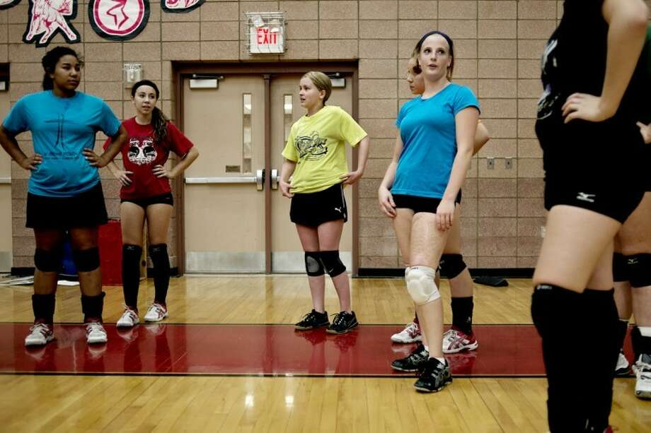 "SEAN PROCTOR | sproctor@mdn.netKirsten Longstreth, center, wearing a yellow shirt, takes part in practice with her teammates, including Ashton Snyder, left, Jasmyn Parker-Urban, and Chloe Zukar at Beaverton High School. Longstreth was diagnosed with Hodgkins Lymphoma in March and subsequently went through eight cycles of chemotherapy. Her coach, Steve Evans, wasn't sure she would be able to play this season, but is excited to have her back on the team. ""She has a good attitude and is a hard worker. A team player and a great participator,"" he said. Photo: Sean Proctor"