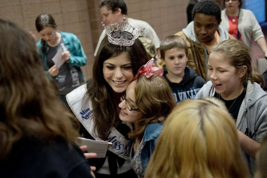 NICK KING | nking@mdn.netMiss Michigan Angela Venditti, left, hugs Bullock Creek Middle School eighth-grader NIcole Mead after speaking Tuesday at the Bullock Creek High School auditorium. Photo: Nick King/Midland  Daily News