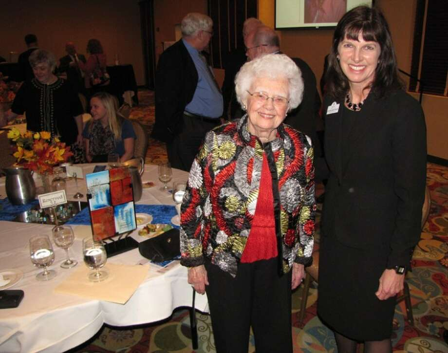 Erich T. Doerr | for the Daily NewsMidland Area Community Foundation Philanthropist of the Year Mildred Putnam, left, poses with Foundation President Sharon Mortensen. Her award is visible on the table.