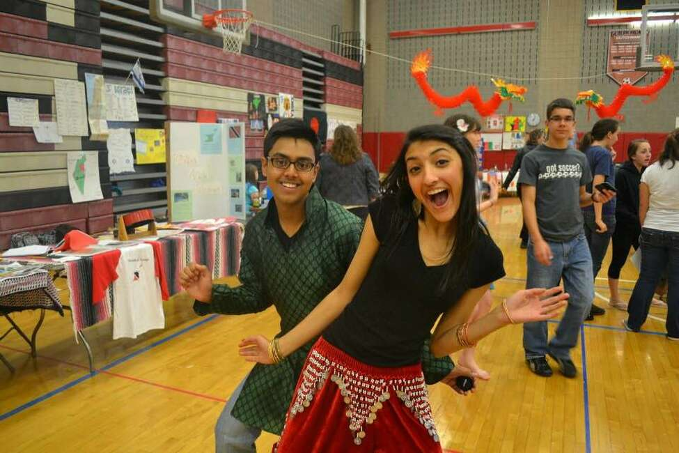 Reza Sayeed, left, and Oindri Sen, Guilderland High students and membersof the Indian dance group, pose during the cultural fair at the school gym in 2012. (Photo courtesy of Caroline Grondahl)