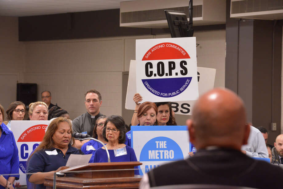 Vanita Rodriguez of the Community Organized for Public Service (COPS) and METRO Alliance speaks during an SAISD trustee meeting in support of SAISD district staff receiving a living wage. Listening at right is trustee Ed Garza. COPS is celebrating more than 40 years of community activism this year. COPS has made San Antonio a better place. Photo: Robin Jerstad /San Antonio Express-News