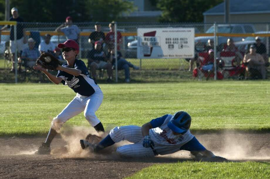 BRITTNEY LOHMILLER | blohmiller@mdn.netMartin Money of Northeast slides into second before Drew Gandy of Fraternal Northwest can tag him out in the second inning. Photo: Brittney Lohmiller