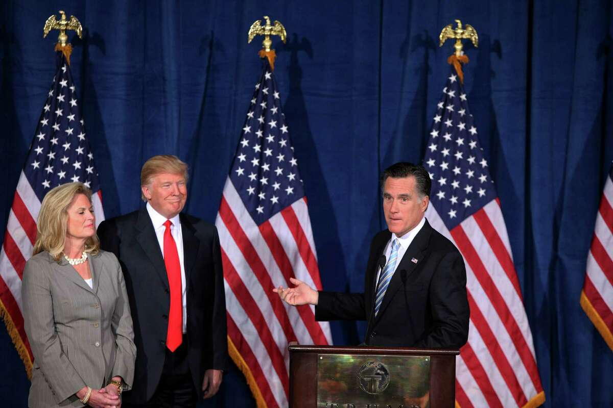 Donald Trump announces his endorsement of then Republican presidential hopeful Mitt Romney, right, as Ann Romney looks on at the Trump International Hotel in Las Vegas in 2012. A reader says Romney is hypocritical for now condemning the man whose endorsement he accepted four years ago.