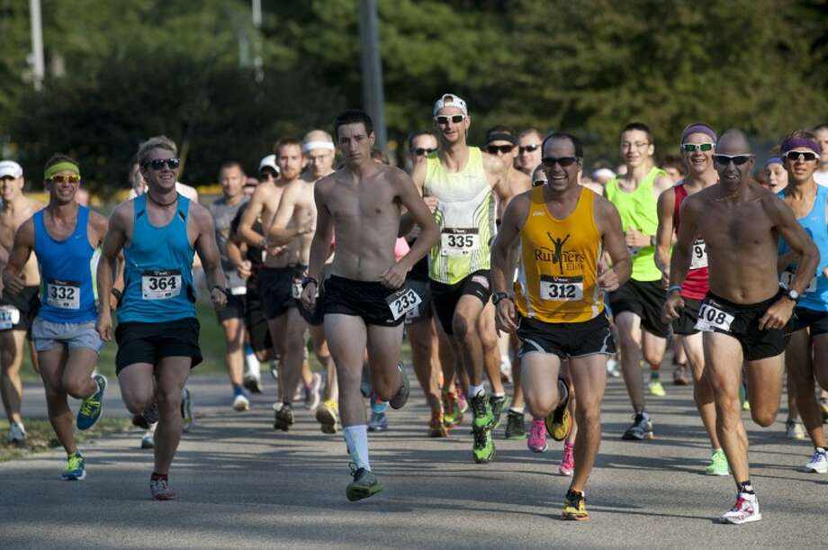 BRITTNEY LOHMILLER | blohmiller@mdn.netRunners take off from the starting line of the second annual Coach Bob Cole Memorial 5K in Sanford Saturday morning. Over 375 runners and walkers came out to participate in the 5k. Photo: Brittney Lohmiller