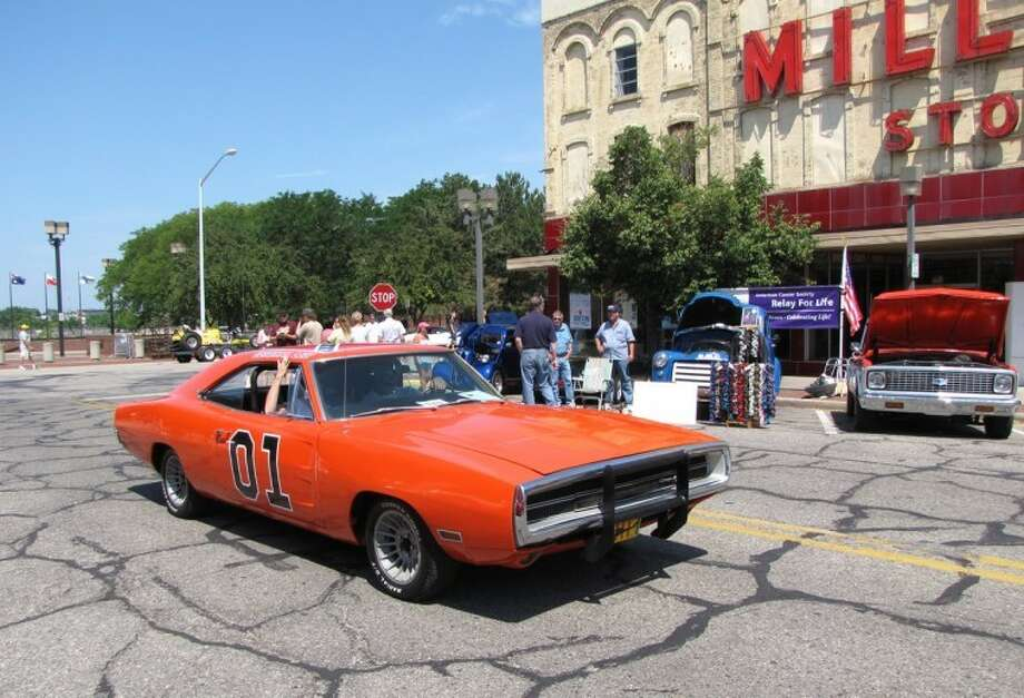 "Erich T. Doerr | for the Daily NewsThe General Lee, a replica of the Dodge Charger from the popular ""Dukes of Hazzard"" television show, drives up Bay City's Center Avenue tooting its custom Dixie horn during the Cool City car show. The car was on its way to compete in the car show's ""Exhaust Rapping"" contest for engine noise."