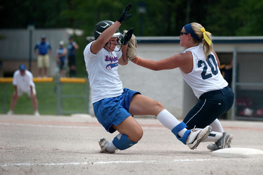 Ariel Cammin of the Midland Lady Explorers tries to slide into third base before Natalie Lampman of Ann Arbor Gold catches the ball in the fourth inning of Lady Explorers game against Gold on Saturday. This is the only tournament the Lady Explorers will have for the summer. Photo: Brittney Lohmiller / Midland Daily News
