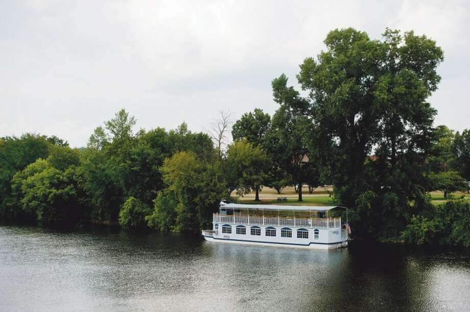 NICK KING | nking@mdn.netThe Grand Princess river boat sits docked in the Tittabawassee River at Chippewassee Park. Photo: Nick King/Midland  Daily News