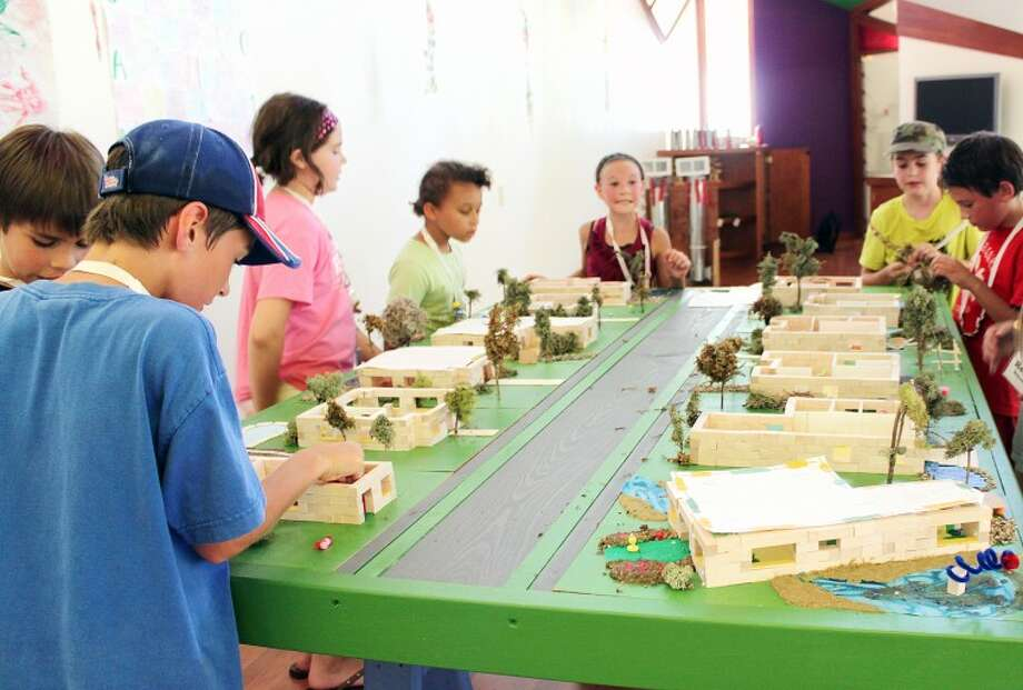 Provided by the Alden B. Dow Home & StudioCampers work on designing and building miniature houses recently during architecture camp at the Alden B. Dow Home & Studio. Campers designed the houses on paper and then made three-dimensional models, scaled at one inch equal to four feet actual size.
