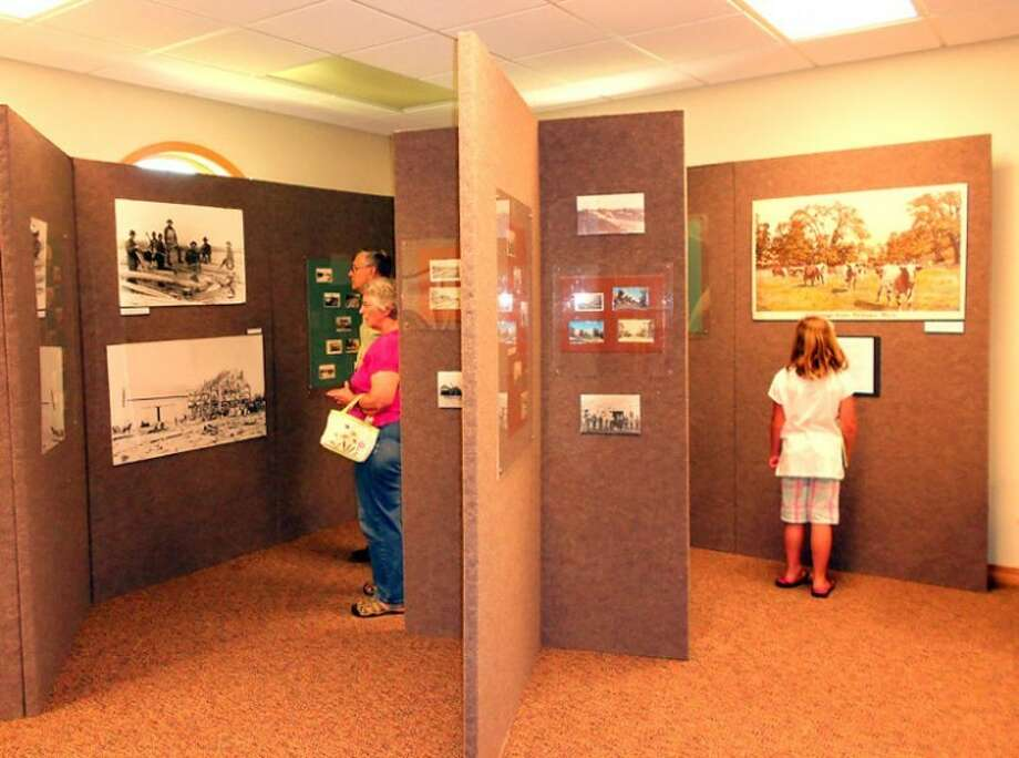 Photo providedSheryl and Bernie Ruhle, of Coleman, and Sophia Adams, 7, get a first look at the new exhibit.