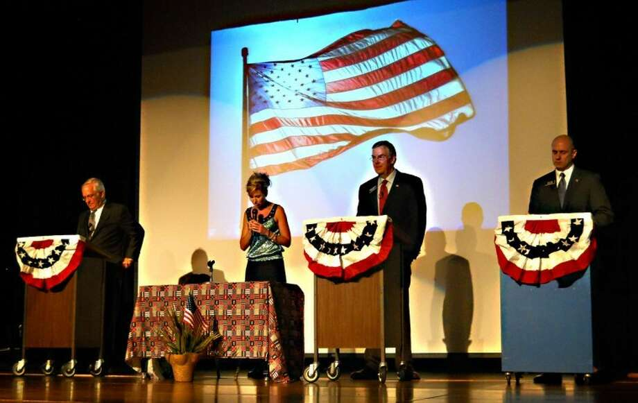 Traci L. Weisenbach | for the Daily NewsThe Huron County Teenage Republicans hosted a GOP U.S. Senate debate Thursday night at Unionville-Sebewaing Area High School auditorium. Three of the four invited candidates attended. Pictured from the left are candidate Clark Durant, moderator Kathy Hoekstra, candidate Randy Hekman and candidate Gary Glenn. The debate covered a variety of topics, such as agriculture, health care, student debt, Social Security and political corruption. Approximately 200 people attended the event.