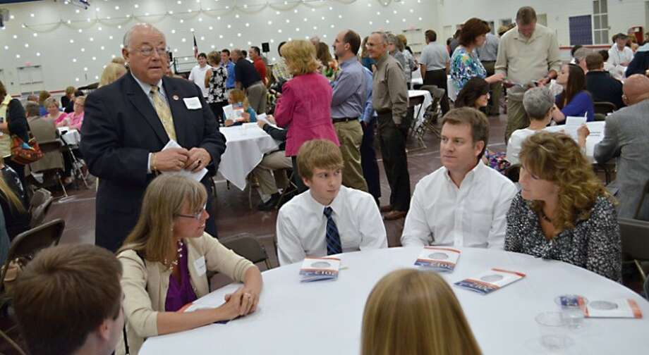 Photo providedScholarship donors Eileen Pearson and John Reder (former Midland County Sheriff) speak with recipients at the 2012 scholarship award banquet hosted by the Midland Area Community Foundation. Photo: Picasa