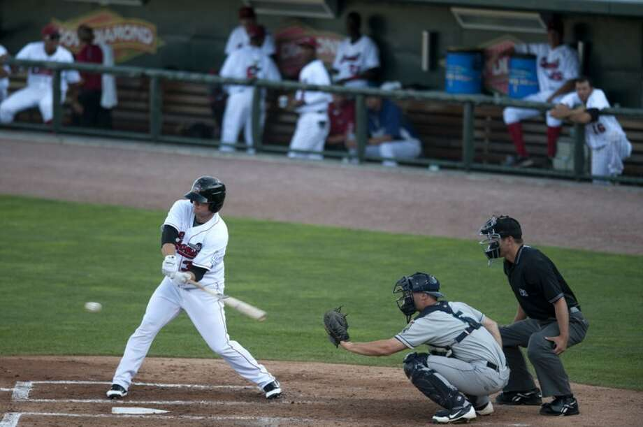 BRITTNEY LOHMILLER | blohmiller@mdn.netScott Schebler of the Great Lakes Loons swings at a pitch from Cedar Rapids Kernels pitcher Frank De Jiulio. Photo: Brittney Lohmiller