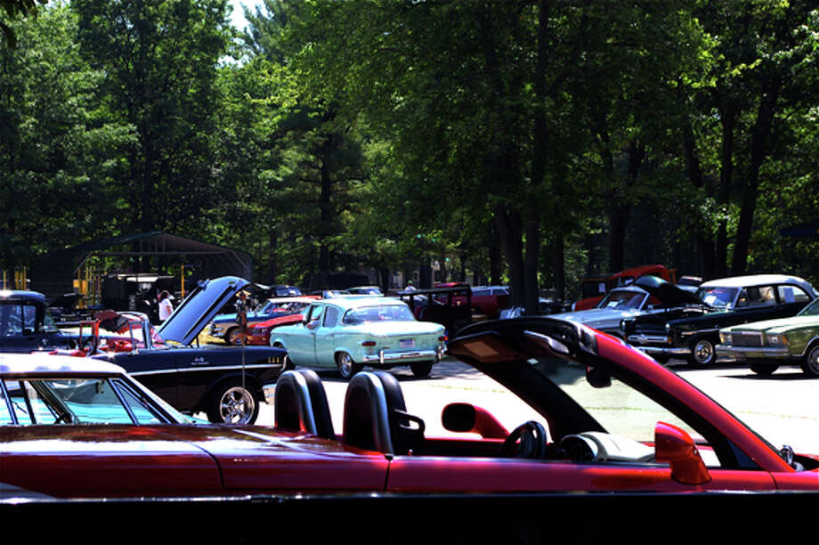 Dozens of vehicles line the parking lot on Friday at the Senior Services' Greendale center for the annual antique car show. Photo by Stuart Frohm