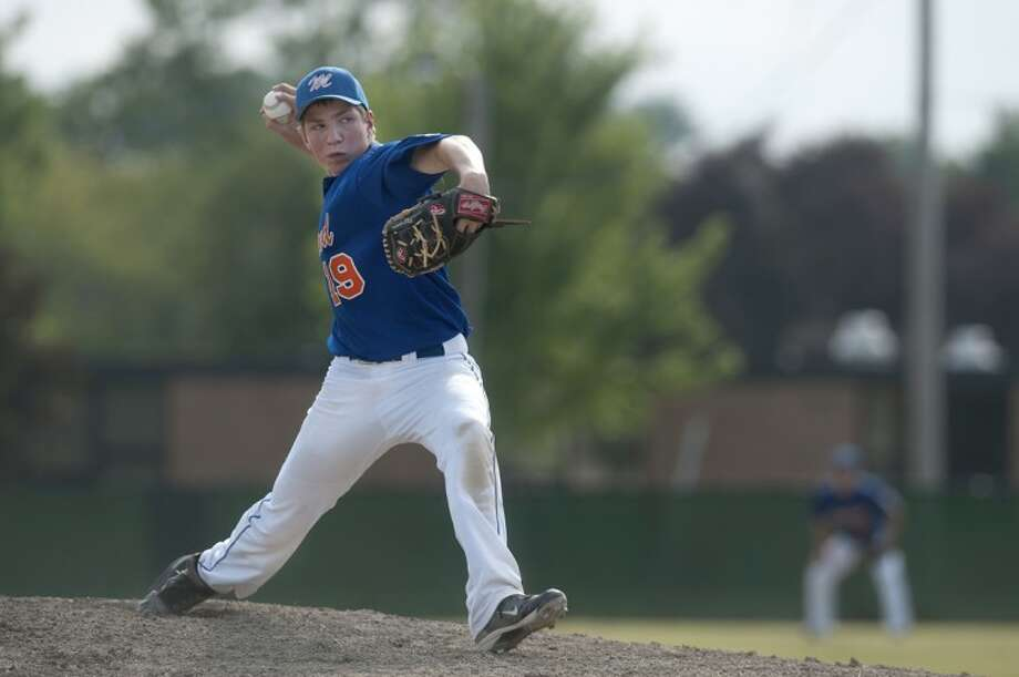 BRITTNEY LOHMILLER | blohmiller@mdn.netMatt Flanagan of Midland pitches in the championship game of the Junior League Baseball district tournament against Freeland-Sanford Wednesday evening in Freeland. Midland won the game 9-4 in 8 innings. Photo: Brittney Lohmiller