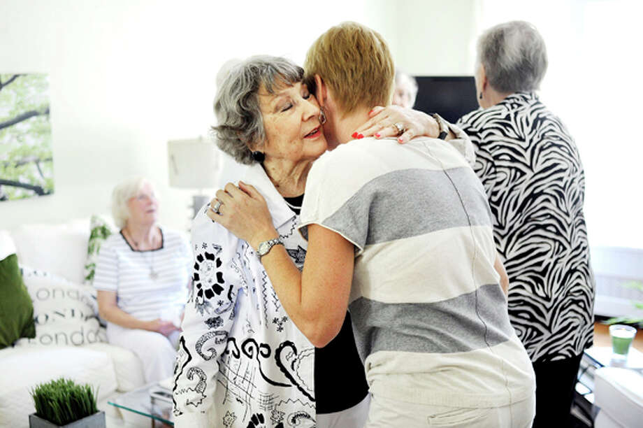 NICK KING | nking@mdn.netMarge Hahnenberg, left, hugs her granddaughter Jenny DeVivo during Marge's surprise 90th birthday party at Marge's daughter Marji Noesen's house in Midland on Friday. Marge is the founder of the Sweet Adelines Chrous chapter in Midland, which is celebrating its 50th anniversary.