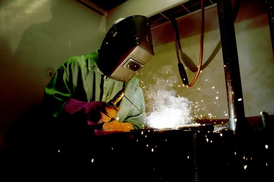 NEIL BLAKE   nblake@mdn.netAndy Porterfield, 16, of Midland, practices welding at the Construction & Technology Camp at Delta College on Tuesday. Campers could enroll in one of five programs to get hands-on training while working on projects. Photo: Neil Blake/Midland  Daily News