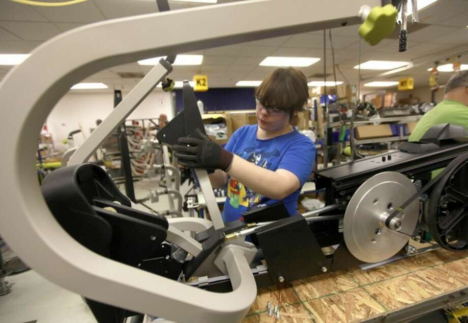 AP Photo | Detroit Free Press, William ArchieElicia Atwell, 22, works on the T-4 assembly line at the NuStep plant in Ann Arbor. NuStep exports some of its exercise machines to Europe and has seen a slowdown in European sales this year. Photo: William Archie
