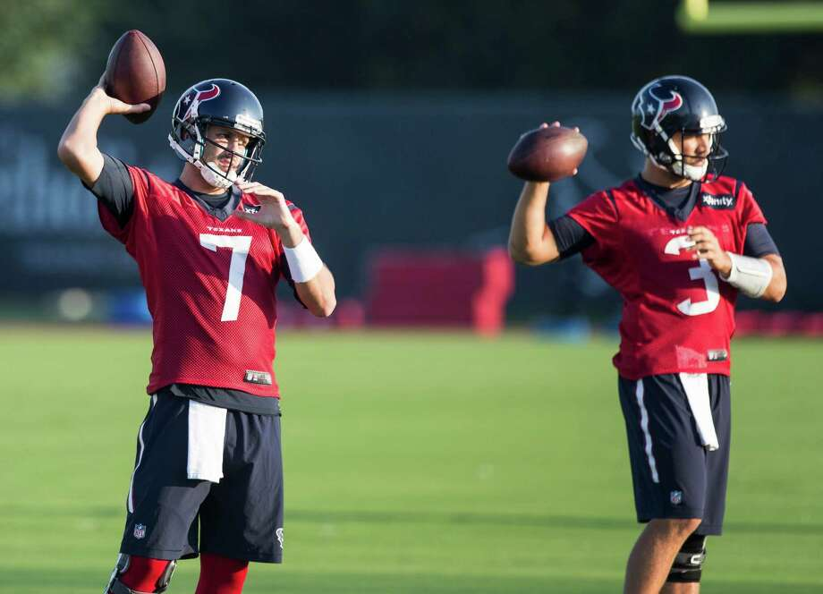 Bill O'Brien says Tom Savage, right, has the ability to win the backup quarterback job, but Brian Hoyer, left, will begin as the No. 2. Photo: Brett Coomer, Staff / © 2015 Houston Chronicle