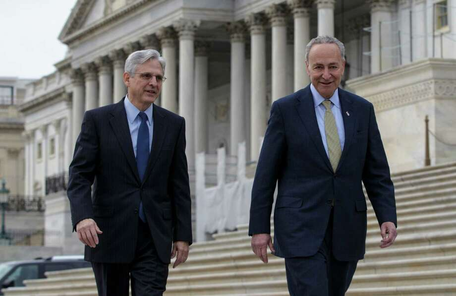 Senate Judiciary Committee member Sen. Charles Schumer, D-N.Y., right, which considers judicial nominations, walks with Judge Merrick Garland, President Barack Obama's choice to replace the late Justice Antonin Scalia on the Supreme Court, Tuesday, March 22, 2016, on Capitol Hill in Washington. Senate Majority Leader Mitch McConnell of Ky. has been steadfast in his refusal to hold a confirmation hearing for any nominee during the waning months of Obama's presidency.  (AP Photo/J. Scott Applewhite) ORG XMIT: DCSA105 Photo: J. Scott Applewhite / AP