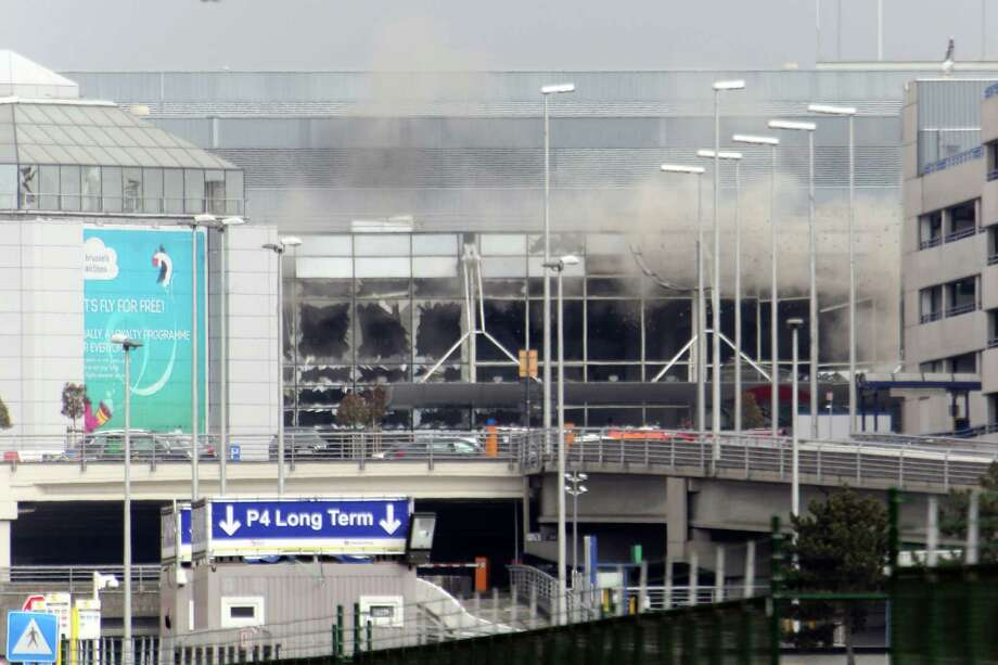 BRUSSELS, BELGIUM - MARCH 22:  A plume of smoke rises over Brussels airport after the controlled explosion of a third device in Zaventem Bruxelles International Airport after a terrorist attack on March 22, 2016 in Brussels, Belgium. At least 31 people are thought to have been killed after Brussels airport and a Metro station were targeted by explosions. The attacks come just days after a key suspect in the Paris attacks, Salah Abdeslam, was captured in Brussels. (Photo by Sylvain Lefevre/Getty Images) ORG XMIT: 614921197 Photo: Sylvain Lefevre / 2016 Getty Images