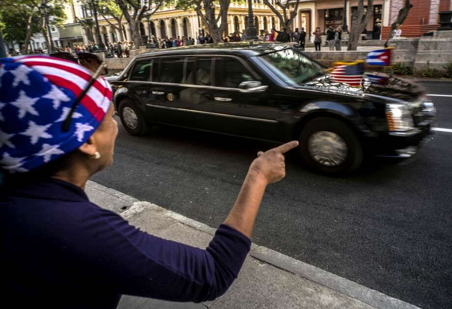 In Havana March 22, a woman pointed out the U.S. presidential limousine carrying President Barack Obama. Photo: Ramon Espinosa, AP