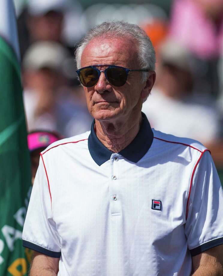 """(FILES) This file photo taken on March 20, 2016 shows  Indian Wells Tennis Garden CEO Raymond Moore attending the trophy presentation ceremony after the men's final at the BNP Paribas Open at the Indian Wells Tennis Garden in Indian Wells, California, March 20, 2016. Indian Wells tournament director Raymond Moore resigned on March 21, 2016 after coming under heavy fire for saying women's tennis """"ride(s) on the coat-tails of the men"""".  / AFP PHOTO / ROBYN BECKROBYN BECK/AFP/Getty Images ORG XMIT: Indian We Photo: ROBYN BECK / AFP or licensors"""