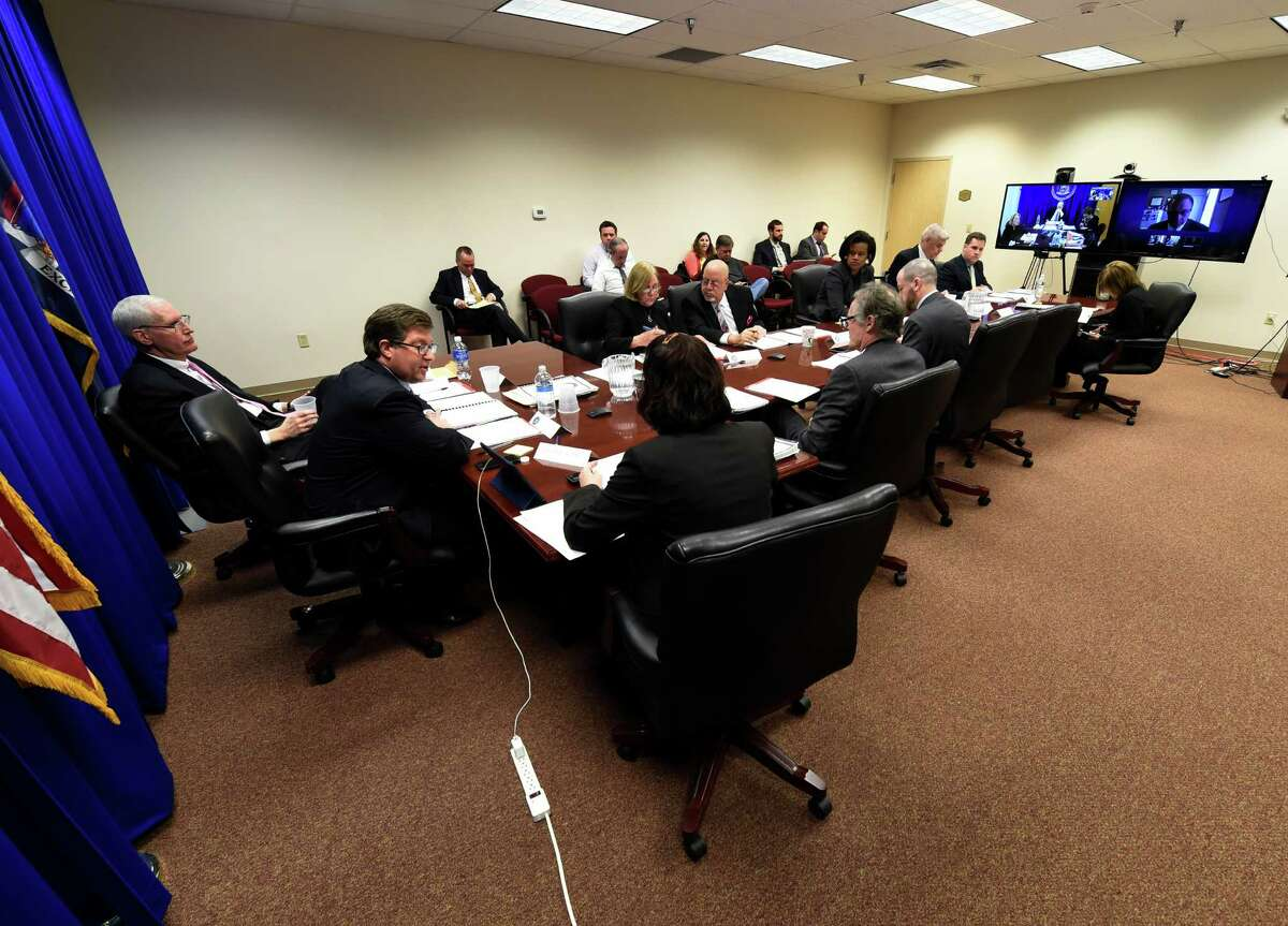 Chair Daniel J. Horwitz, far left, leads a meeting of the Joint Commission on Public Ethics at their offices Tuesday March 22, 2016 in Albany , N.Y. (Skip Dickstein/Times Union)