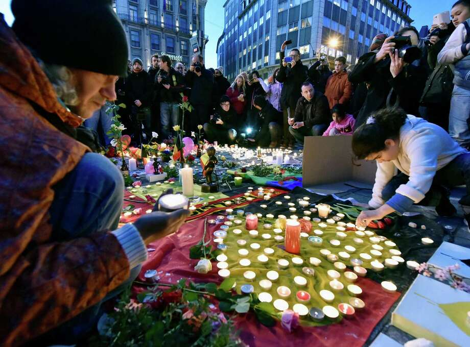 Mourners gather at Place de la Bourse in Brussels on Tuesday after deadly bombs struck the city. Photo: Martin Meissner, STR / AP