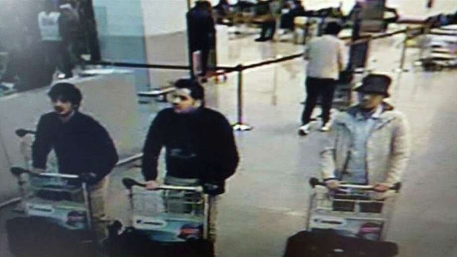 In this image provided by the Belgian Federal Police in Brussels on Tuesday, March 22, 2016 of three men who are suspected of taking part in the attacks at Belgium's Zaventem Airport. The man at right is still being sought by the police and two others in the photo that the police issued were according to a the Belgian Prosecutors 'probably' suicide bombers. Bombs exploded at the Brussels airport and one of the city's metro stations Tuesday, killing and wounding scores of people, as a European capital was again locked down amid heightened security threats. (Belgian Federal Police via AP) ORG XMIT: VLM170 / Belgian Federal Police