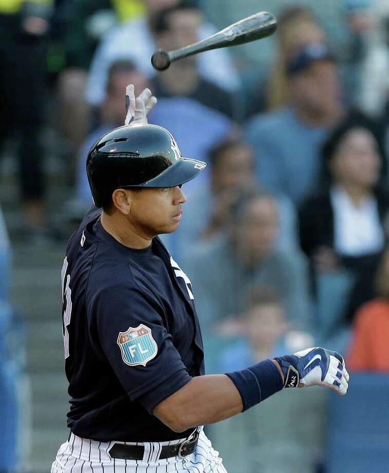 New York Yankees' Alex Rodriguez flips his bat as he watches his two-run single off New York Mets starting pitcher Steven Matz during the second inning of a spring training baseball game Tuesday, March 22, 2016, in Tampa, Fla. Yankees' Brett Gardner and Didi Gregorius both scored on the hit. (AP Photo/Chris O'Meara)  ORG XMIT: FLCO113 Photo: Chris O'Meara / AP