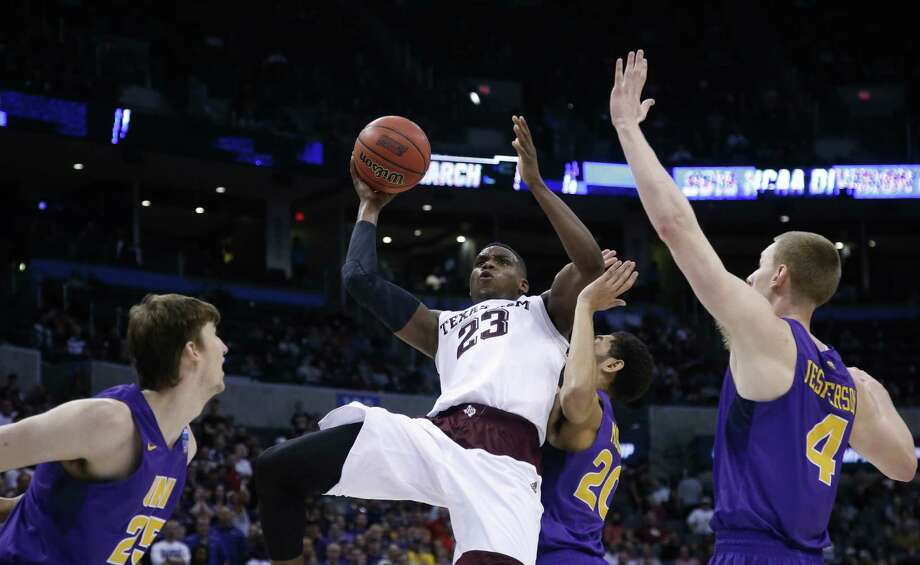 Texas A&M guard Danuel House (23) shoots between Northern Iowa forward Bennett Koch (25), forward Klint Carlson (20) and guard Paul Jesperson (4) in the second  half of a second-round men's college basketball game in the NCAA Tournament Sunday, March 20, 2016, in Oklahoma City. Texas A&M won 92-88 in double overtime. (AP Photo/Sue Ogrocki)  ORG XMIT: OKSO153 Photo: Sue Ogrocki / AP