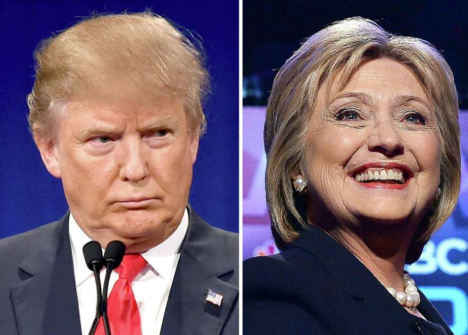 (FILES) This file photo taken on March 2, 2016 shows a combination of file photos of Republican presidential hopeful Donald Trump on January 14, 2016 and his Democratic rival Hillary Clinton on February 4, 2016.  Voters went to the polls March 22, 2016 in Arizona to cast ballots in Republican and Democratic primaries, the latest White House nominating contest and one in which immigration figures prominently. Pre-elections polls showed frontrunner Donald Trump, with endorsements from tough-on-immigrants Sheriff Joe Arpaio and former governor Jan Brewer, favored to win over rivals Ted Cruz and John Kasich, the remaining Republicans in a narrowing presidential race. Hillary Clinton, the Democratic frontrunner, also was expected to do well against Vermont Senator Bernie Sanders in a state with a large Hispanic community.  / AFP PHOTO / DSKDSK/AFP/Getty Images Photo: DSK / AFP/Getty Images / AFP or licensors