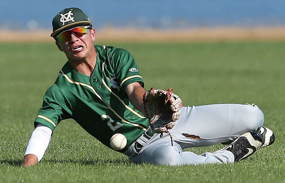 Cowboys center fielder Mark Villarreal is force to grab a fly ball on the hop in the second inning due to windy conditions knocking it down as McCollum beats Highlands 8-5 in 28-5A baseball at the SAISD Complex on March 22, 2016. Photo: TOM REEL, STAFF / SAN ANTONIO EXPRESS-NEWS / 2016 SAN ANTONIO EXPRESS-NEWS