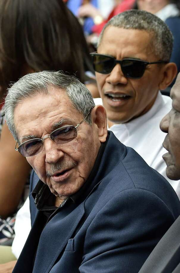 US President Barack Obama and Cuban President Raul Castro (L) wait for the start of a baseball game between the Tampa Bay Rays and the Cuban national team at the Estadio Latinoamericano in Havana on March 22, 2016.      AFP PHOTO/Nicholas KAMMNICHOLAS KAMM/AFP/Getty Images Photo: NICHOLAS KAMM / Nicholas Kamm/AFP