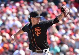TEMPE, AZ - MARCH 12:  Jake Peavy #22 of the San Francisco Giants delivers a first inning pitch against the Los Angeles Angels of Anaheim at Tempe Diablo Stadium on March 12, 2016 in Tempe, Arizona.  (Photo by Norm Hall/Getty Images)