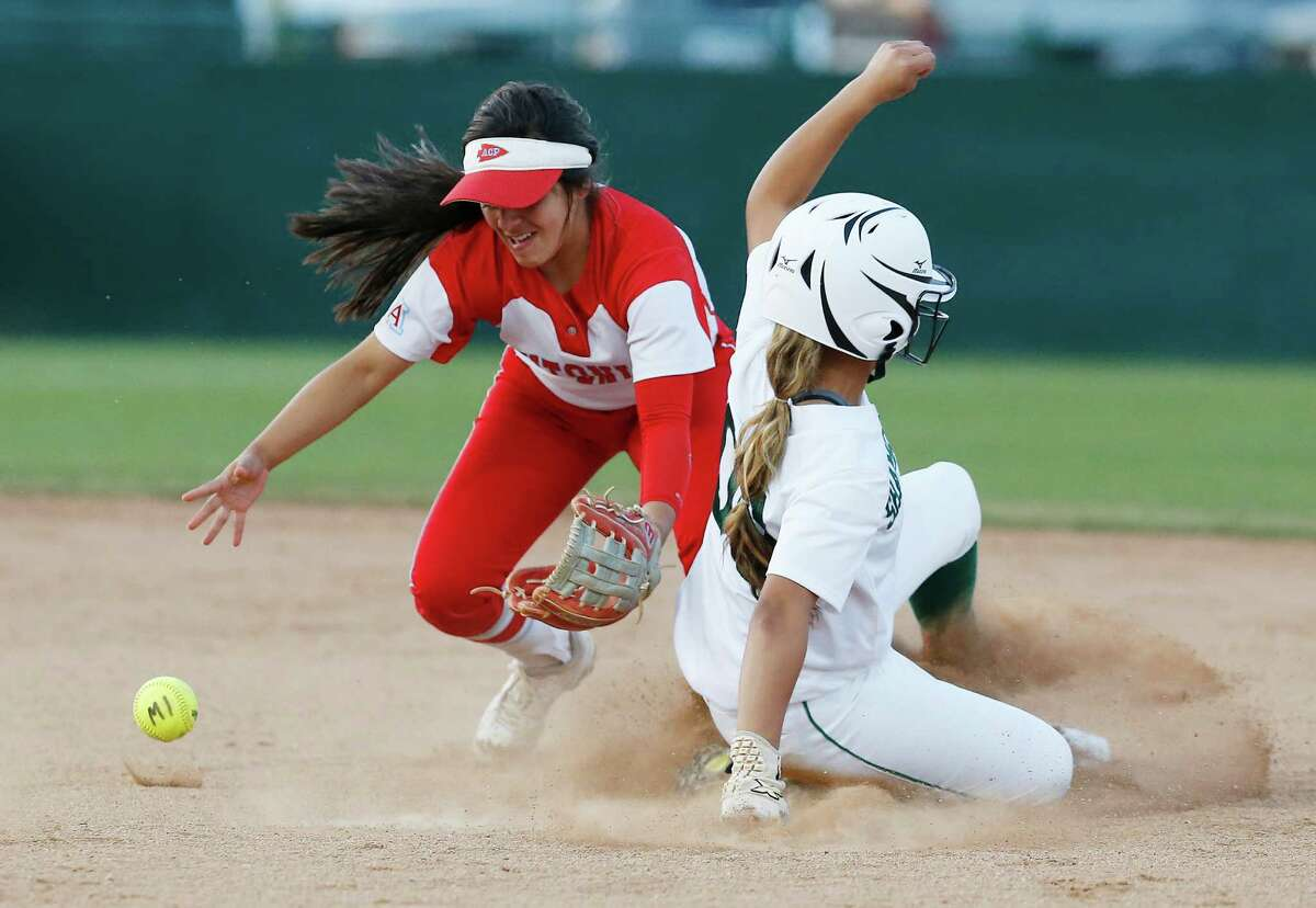Antonian's Kaylee Villarreal (left) is unable to field the ball for an out at second against Incarnate Word's Alyssa Pinto (right) during their TAPPS 2-5A softball game on March 22, 2016.