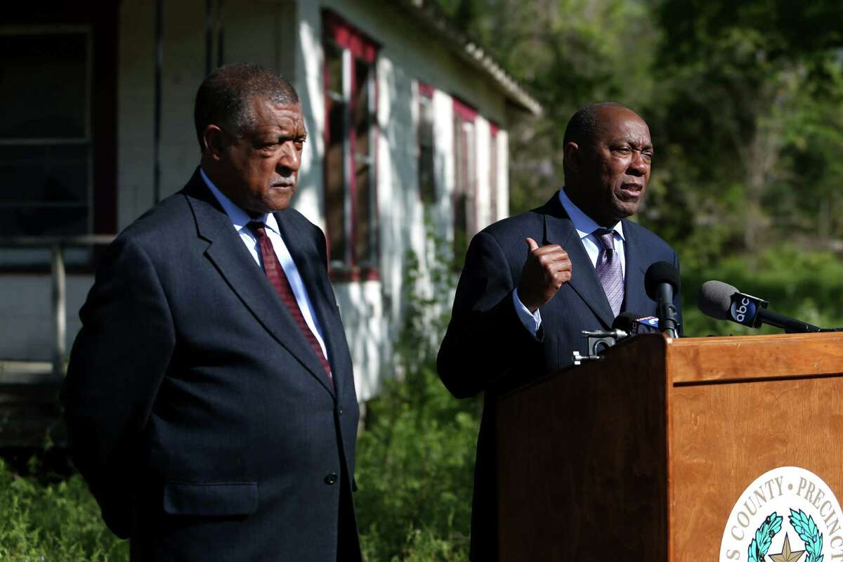 Harris County Commissioner Gene L. Locke is joined by Houston Mayor Sylvester Turner to officially launch a program designed to remove debris and clean dozens of neglected and vacant lots in Houston neighborhoods throughout Precinct One, Tuesday, March 22, 2016, in Houston, Texas. Precinct One crews and contractors remove trash and board up a home along the 1300 block of West Little York Rd.