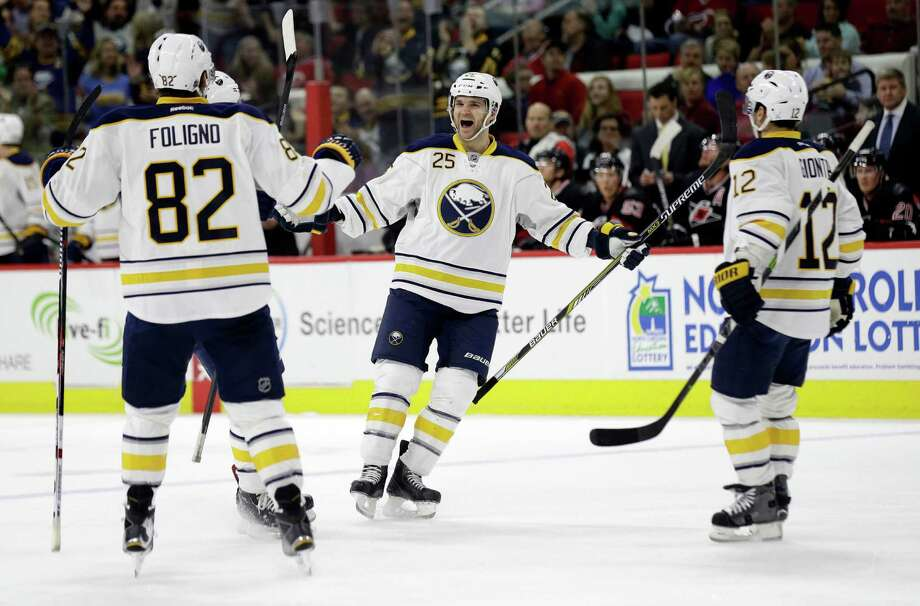 Buffalo Sabres' Carlo Colaiacovo (25) celebrates with Marcus Foligno (82) and Brian Gionta (12) following Colaiacovo's goal against the Carolina Hurricanes during the first period of an NHL hockey game in Raleigh, N.C., Tuesday, March 22, 2016. (AP Photo/Gerry Broome) ORG XMIT: NCGB104 Photo: Gerry Broome / AP