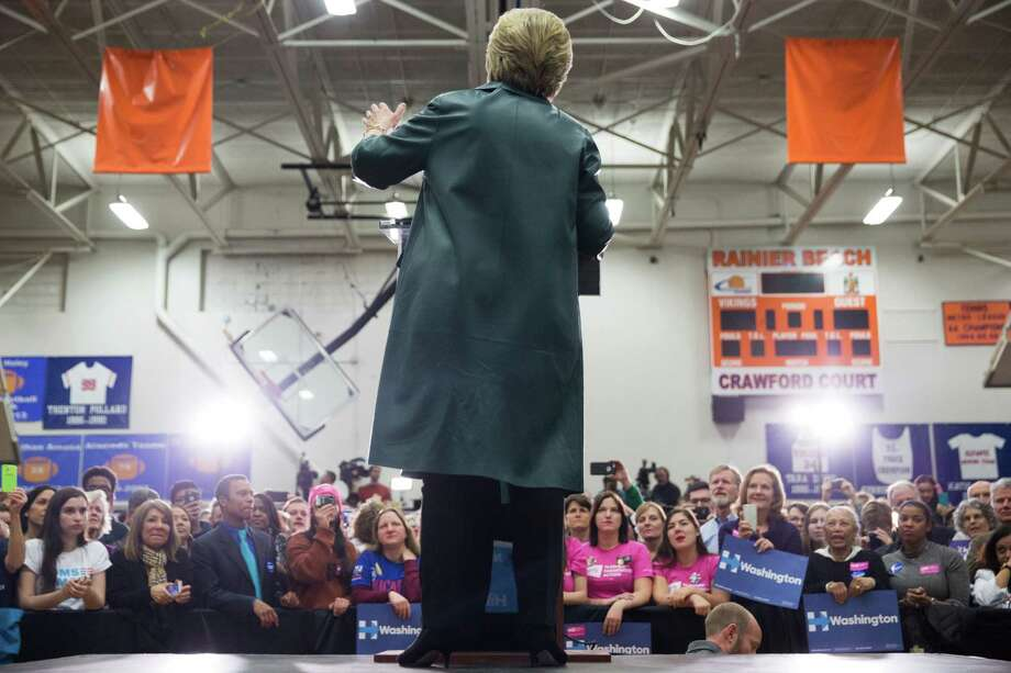 Hillary Clinton speaks at a March rally at Rainier Beach High School, one public speech she has given here in the last eight years. Will Bernie Sanders have her back in the fall campaign? . Photo: GRANT HINDSLEY, SEATTLEPI.COM / SEATTLEPI.COM
