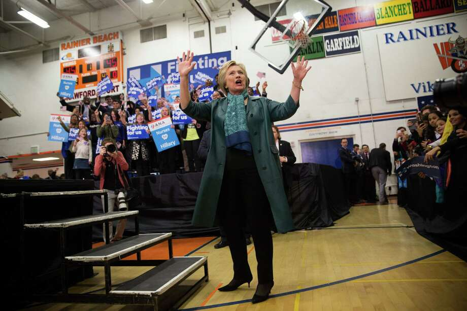 The candidate's one public event here this year. Democratic presidential nominee Hillary Clinton takes the floor during a rally at Rainier Beach High School in Seattle on Tuesday, Mar. 22, 2016. Photo: GRANT HINDSLEY, SEATTLEPI.COM / SEATTLEPI.COM