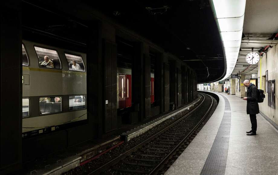 A man waits on an empty train platform at the Central Station in Brussels on Wednesday, March 23, 2016. Belgian authorities were searching Wednesday for a top suspect in the country's deadliest attacks in decades, as the European Union's capital awoke under guard and with limited public transport after 34 were killed in bombings on the Brussels airport and a subway station. Photo: Valentin Bianchi, AP / AP